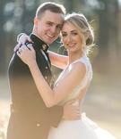 Bride and groom wedding portrait groom in military dress blues uniform