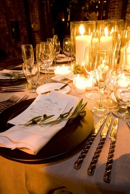 Wedding reception table covered with candles