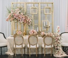 taupe tablescape with embroidered linen cascading floral runner made up of pink roses gold detailing