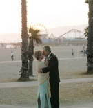 Older couple embrace on Santa Monica beach