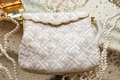 Beaded white purse with gold scallop edges and gold hardware pearls