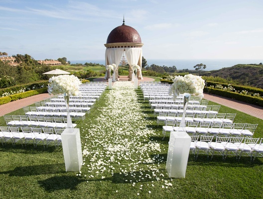 outdoor ceremony space gold course ocean white chairs flower petals dome pelican hill resort ca