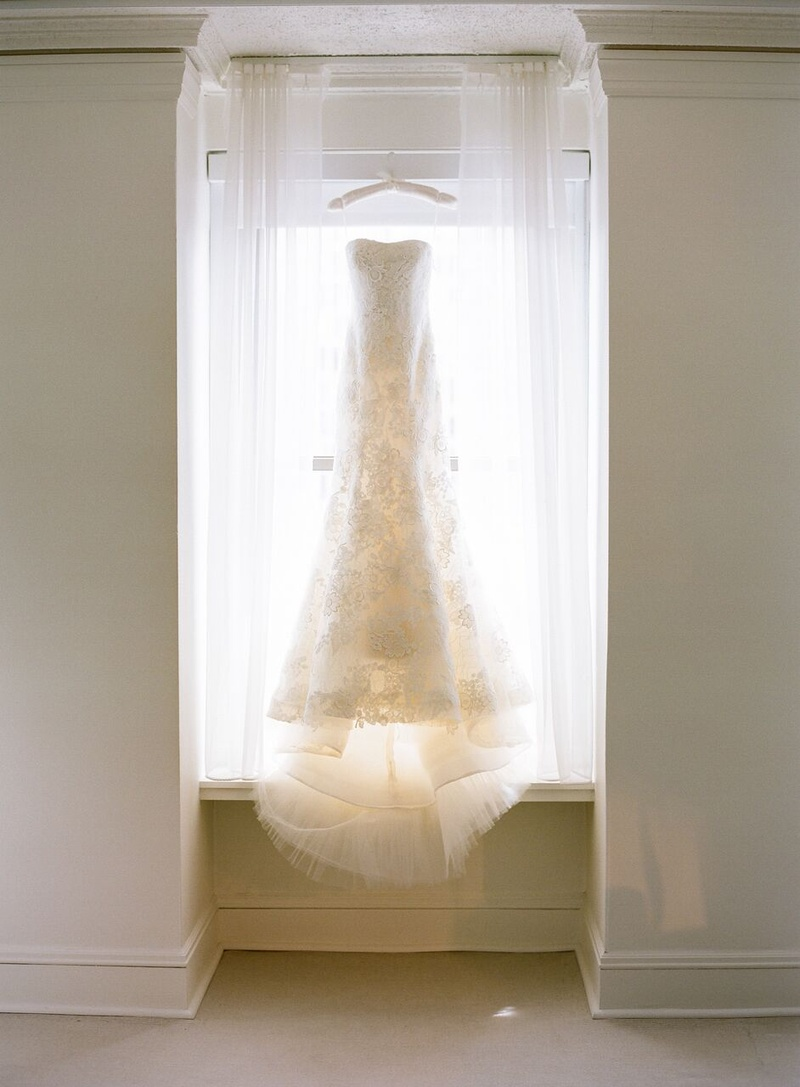 lace vera wang gown with sweetheart neckline on hanger in white bridal suite