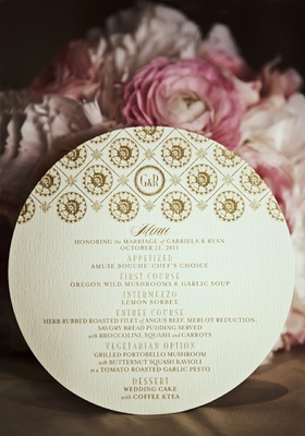 Gold motif and monogram on circular menu