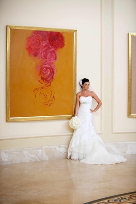 Rosa Clara bridal gown next to framed painting