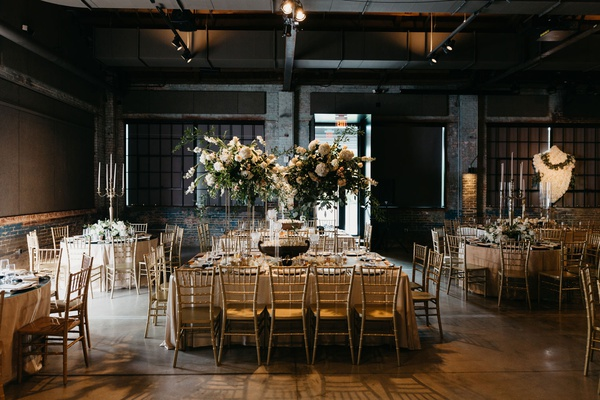 former miss america savvy shields industrial chic wedding brick wall beams gold chairs tall flowers
