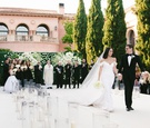 cheryl burke and matthew lawrence wedding ceremony outdoor venue white black greenery recessional