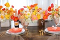 Wood table with table number and poppy flower arrangement Veuve Clicquot Rose