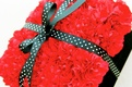 Red carnation wedding ring pillow with polka dot ribbon