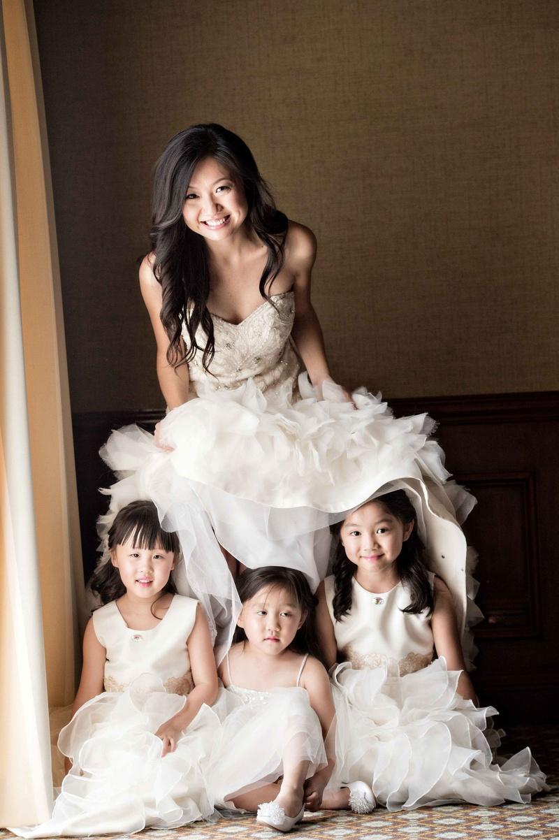 b071e23366 flower girls posing underneath bridal gown white fluffy sweet cute moment  california wedding