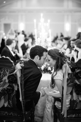 black white photo of bride groom share moment during wedding reception florida foreheads