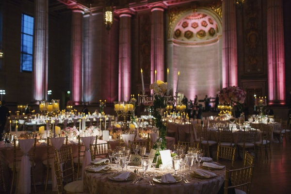 Round and rectangular tables in marble column auditorium