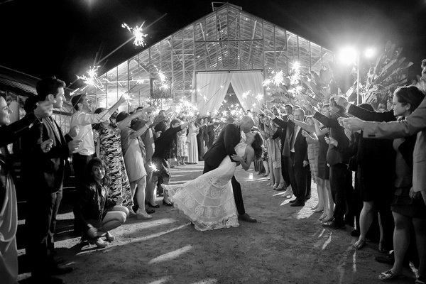 black and white photo of bride and groom at santa barbara wedding dip sparkler exit