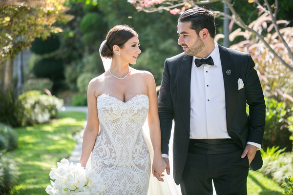 armenian couple, groom holds bride's hand, bride in leah da gloria lace wedding dress