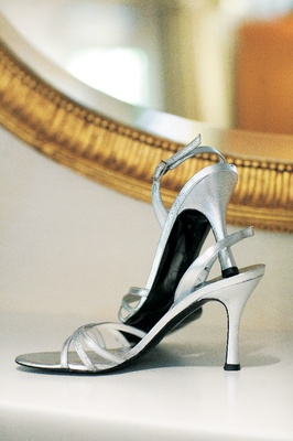 silver sandals with straps across toes and slingback heel
