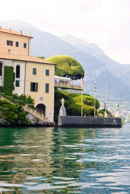 Wedding venue in Italy overlooking water with flags