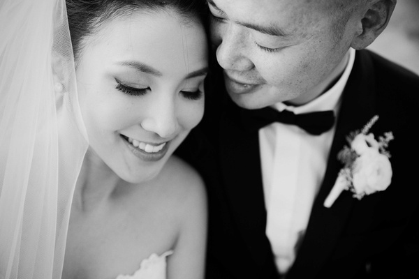 black and white photo of close up of bride and groom