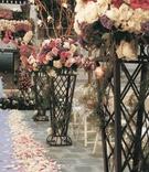 Flower arrangement and petal-lined aisle