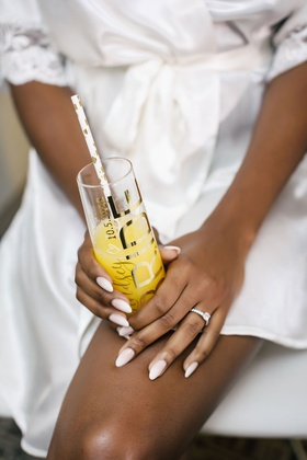 bride with soft manicure white french sheer bride champagne flute straw and engagement ring
