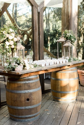 calamigos ranch wedding, escort card table on wine barrels