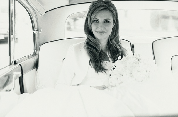 black and white image of bride in getaway car