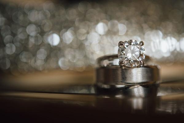 Wedding ring round diamond solitaire engagement ring on men's wedding band brushed