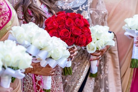 Bride and bridesmaid bouquet with red and white roses