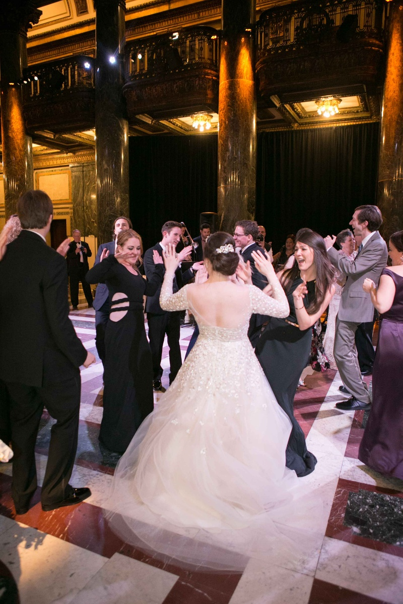 bride twirling dress wedding reception liancarlo low back long sleeves spinning catholic wedding