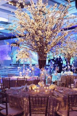 Branches of cherry blossoms tall wedding centerpiece