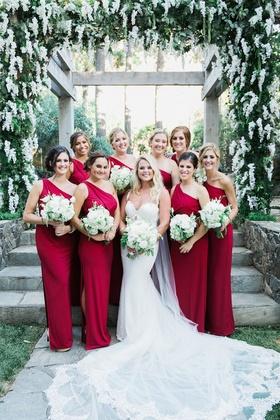 bride in galia lahav, bridesmaids in scarlet one-shoulder dresses with a high slit