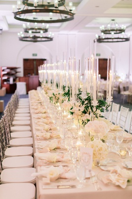 long reception table with blush linen and crystal candelabra down the center