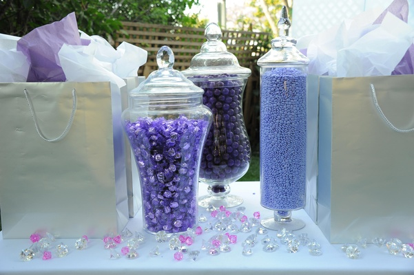 Silver gift bags and purple candy station