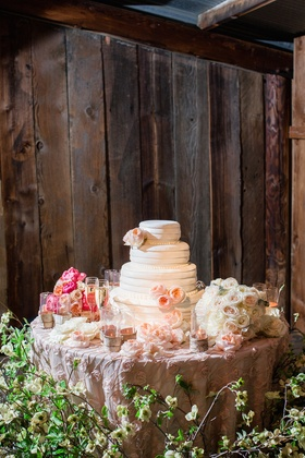 Rustic reception space with floral cake table