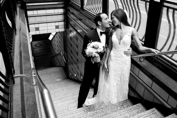 black and white photo of bride and groom wedding portrait on stairs to subway L train chicago