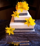 Three layer wedding cake with yellow flowers