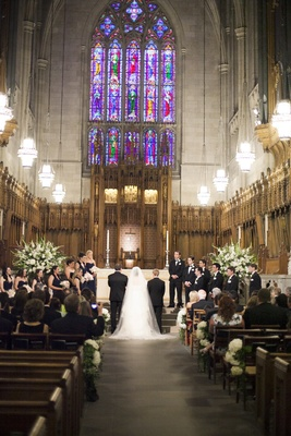 Bride and groom at altar of Duke University Chapel