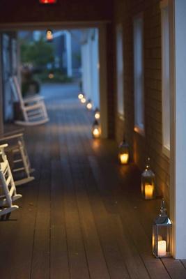 Lanterns on wood floor of yacht club venue porch