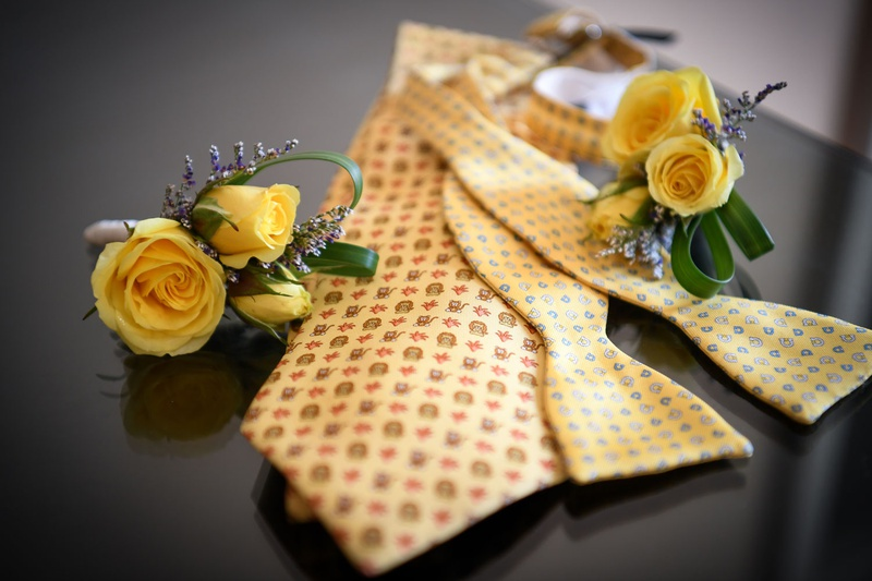 gay lgbt wedding yellow rose boutonniere for ceremony