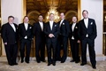 Groomsmen in black tuxedos with white tie and pocket square