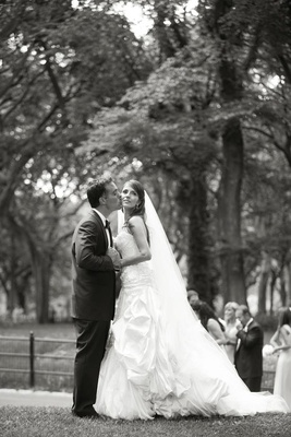 Black and white photo of bride and groom in NYC
