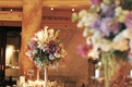Tall centerpiece with candles and purple flowers