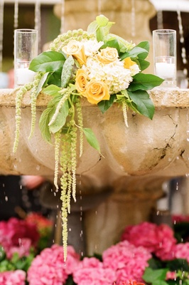 Tropical inspired spring wedding at the bel air bay club inside stone fountain wedding decoration with yellow rose and white hydrangea junglespirit