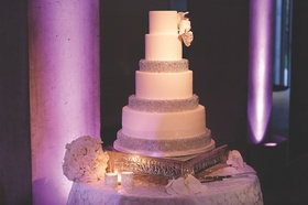 Six tiered wedding cake with beads and flower