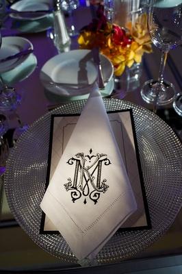 Black embroidered wedding monogram on napkin