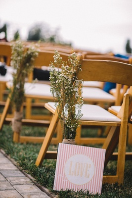 Baby's breath wrapped in burlap on ceremony chair