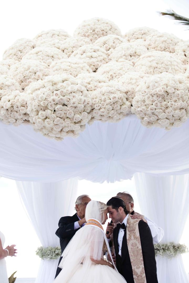 Bride and groom under wedding ceremony structure