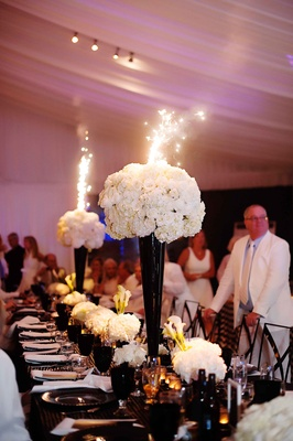 Black and white modern wedding with unique details in cincinnati white tall flower arrangement with sparklers coming out of centerpiece mightylinksfo