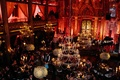Wedding reception at Angel Orensanz Foundation for the Arts with red lighting and beaded chandeliers