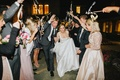 bride and groom wedding grand exit as guests wave streamers