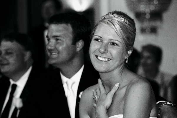 Black and white photo of newlyweds at table